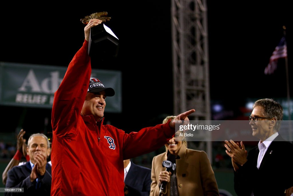 Manager John Farrell of the Boston Red Sox celebrates with the trophy after defeating the Detroit Tigers in Game Six of the American League...
