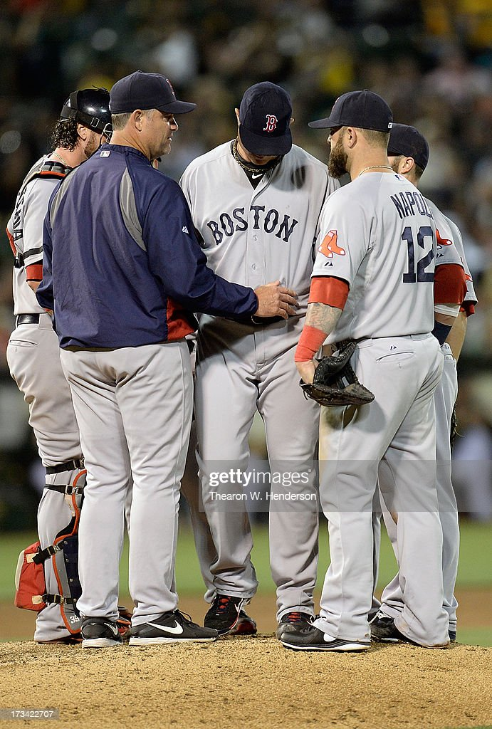 Manager John Farrell #53 of the Boston Red Sox comes out to take pitcher <a gi-track='captionPersonalityLinkClicked' href=/galleries/search?phrase=Jon+Lester&family=editorial&specificpeople=832746 ng-click='$event.stopPropagation()'>Jon Lester</a> #31 out of the game in the seventh inning against the Oakland Athletics at O.co Coliseum on July 13, 2013 in Oakland, California.