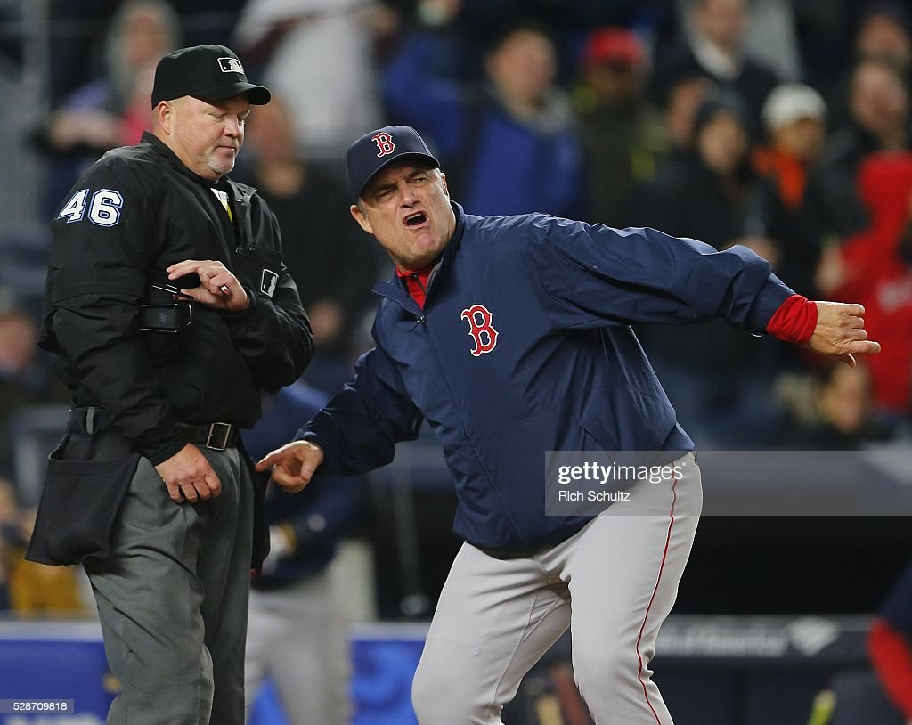 Manager John Farrell #54 of the Boston Red Sox gestures at home plate umpire Ron Kulpa #46 after David Ortiz #34 argued a called strike by home plate umpire Ron Kulpa #46 in the ninth inning during a game at Yankee Stadium on May 6, 2016 in the Bronx borough of New York City. Ortiz was also thrown out of the game as the Yankees defeated the Red Sox 3-2.