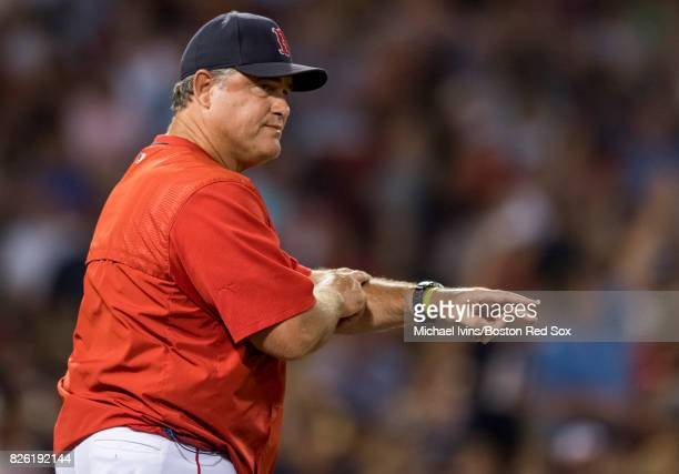 Manager John Farrell of the Boston Red Sox gestures for a pitching change against the Chicago White Sox in the sixth inning on August 3 2017 in...