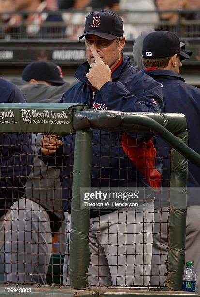 Manager John Farrell of the Boston Red Sox gives signs to his third base coach in the second inning against the San Francisco Giants at ATT Park on...