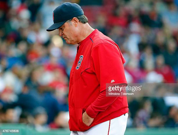 Manager John Farrell of the Boston Red Sox heads back to the dugout during the ninth inning of the game against the Minnesota Twins at Fenway Park on...