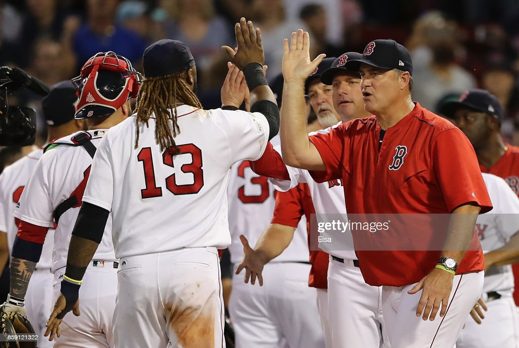 Manager John Farrell of the Boston Red Sox high fives Hanley Ramirez #13 after defeating the Houston Astros 10-3 in game three of the American League Division Series at Fenway Park on October 8, 2017 in Boston, Massachusetts.
