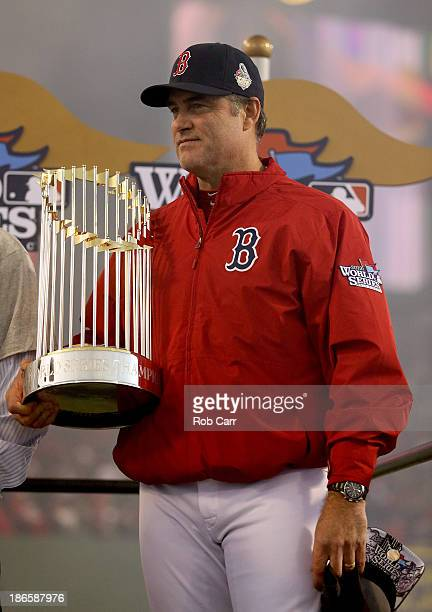 Manager John Farrell of the Boston Red Sox holds up the World Series trophy after defeating the St Louis Cardinals 61 in Game Six of the 2013 World...