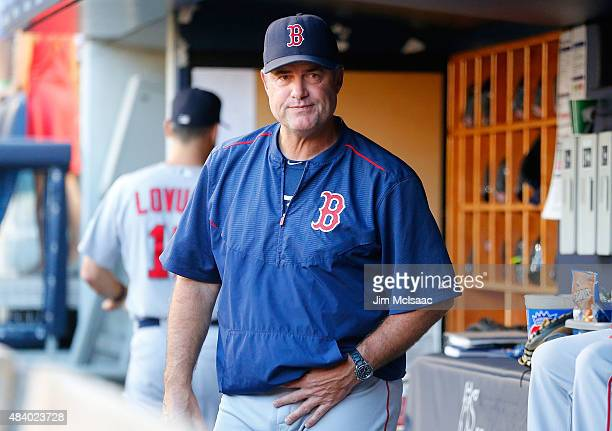 Manager John Farrell of the Boston Red Sox looks on before a game against the New York Yankees at Yankee Stadium on August 4 2015 in the Bronx...