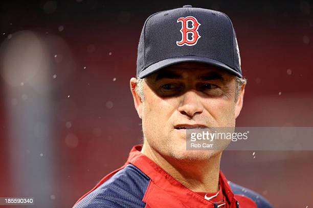 Manager John Farrell of the Boston Red Sox looks on during team workout in the 2013 World Series Media Day at Fenway Park on October 22 2013 in...
