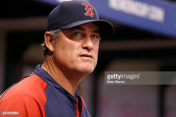Manager John Farrell of the Boston Red Sox looks on from the dugout during the fourth inning of a game against the Tampa Bay Rays on August 29 2014...