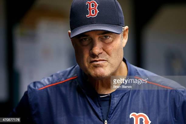 Manager John Farrell of the Boston Red Sox looks on from the dugout during the second inning of a game against the Tampa Bay Rays on April 21 2015 at...