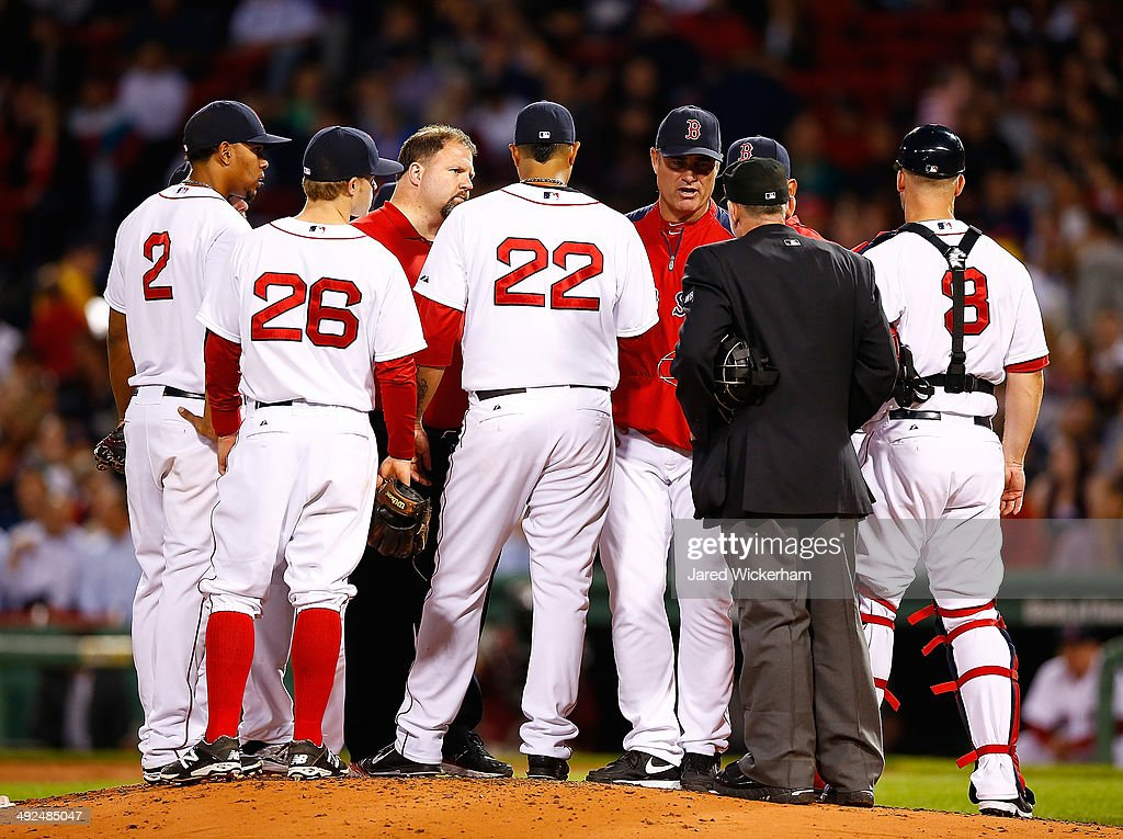 Manager John Farrell #53 of the Boston Red Sox pulls Felix Doubront #22 because of an apparent injury in the fifth inning against the Toronto Blue Jays during the game at Fenway Park on May 20, 2014 in Boston, Massachusetts.