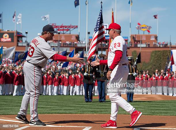 Manager John Farrell of the Boston Red Sox shakes hands with Manager Ryne Sandberg of the Philadelphia Phillies before the start of an opening day...