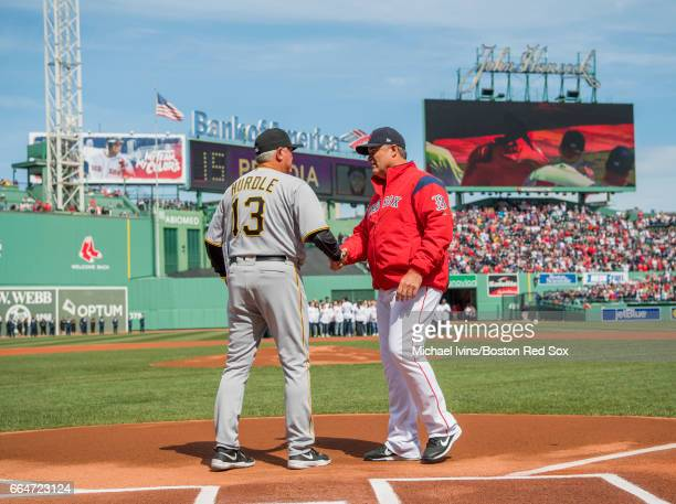 Manager John Farrell of the Boston Red Sox shakes hands with manager Clint Hurdle of the Pittsburgh Pirates before an opening day game at Fenway Park...