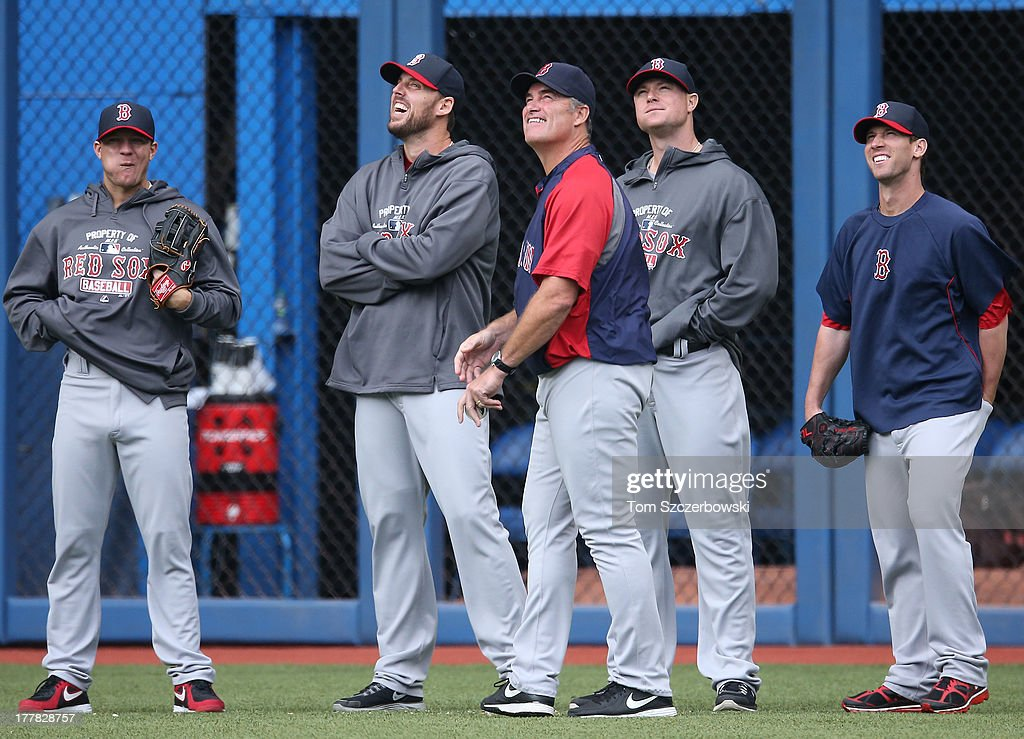 Manager John Farrell #53 of the Boston Red Sox shares a laugh with <a gi-track='captionPersonalityLinkClicked' href=/galleries/search?phrase=Jake+Peavy&family=editorial&specificpeople=211320 ng-click='$event.stopPropagation()'>Jake Peavy</a> #44 and <a gi-track='captionPersonalityLinkClicked' href=/galleries/search?phrase=John+Lackey&family=editorial&specificpeople=171533 ng-click='$event.stopPropagation()'>John Lackey</a> #41 and <a gi-track='captionPersonalityLinkClicked' href=/galleries/search?phrase=Jon+Lester&family=editorial&specificpeople=832746 ng-click='$event.stopPropagation()'>Jon Lester</a> #31 and <a gi-track='captionPersonalityLinkClicked' href=/galleries/search?phrase=Craig+Breslow&family=editorial&specificpeople=836367 ng-click='$event.stopPropagation()'>Craig Breslow</a> #32 during batting practice before the start of MLB game action against the Toronto Blue Jays on August 13, 2013 at Rogers Centre in Toronto, Ontario, Canada.