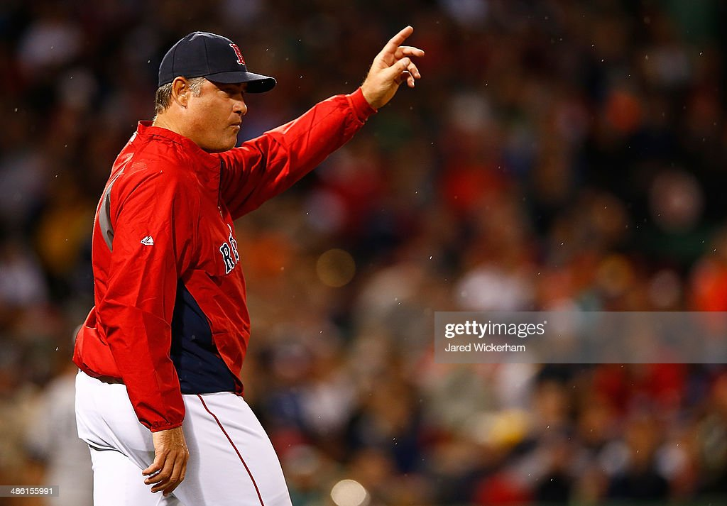Manager John Farrell #53 of the Boston Red Sox signals for a pitching change against the New York Yankees during the game at Fenway Park on April 22, 2014 in Boston, Massachusetts.