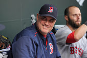 Manager John Farrell of the Boston Red Sox sits in the dugout before the game against the Baltimore Orioles at Oriole Park at Camden Yards on April...