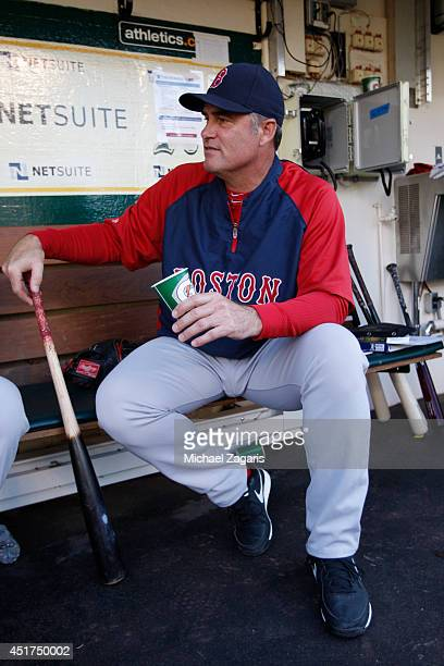 Manager John Farrell of the Boston Red Sox sits in the dugout prior to the game against the Oakland Athletics at Oco Coliseum on June 19 2014 in...