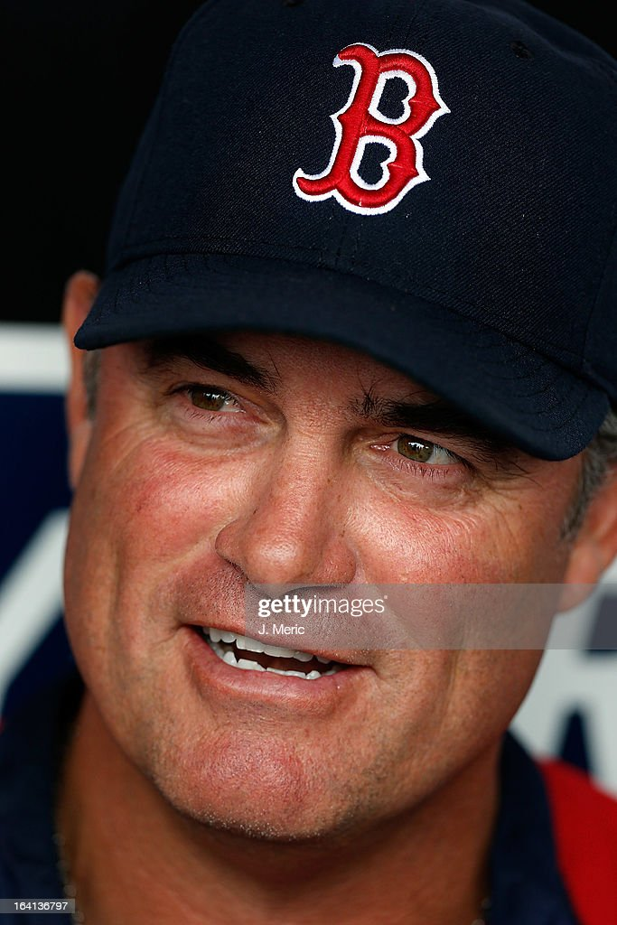 Manager John Farrell #53 of the Boston Red Sox smiles as he talks with the media just before the start of the Grapefruit League Spring Training Game against the New York Yankees at George M. Steinbrenner Field on March 20, 2013 in Tampa, Florida.