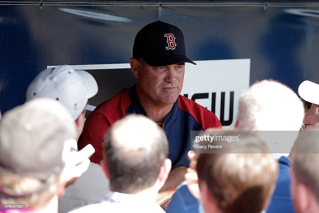 Manager John Farrell of the Boston Red Sox speaks with members of the media prior to a game against the New York Yankees at George M. Steinbrenner Field on March 18, 2014 in Tampa, Florida.