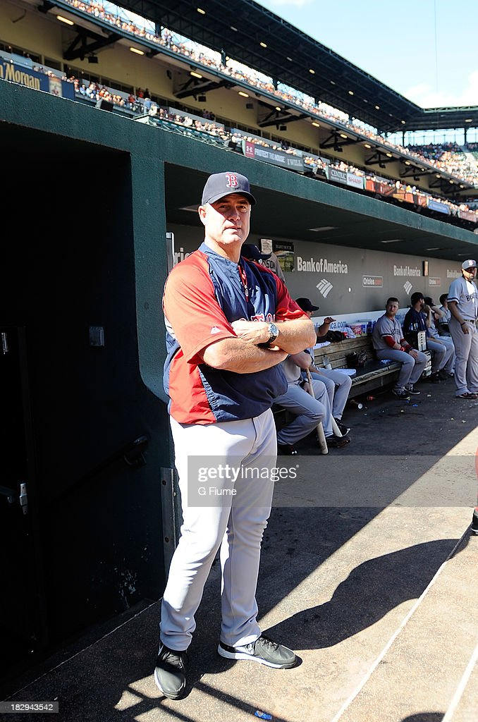 Manager John Farrell #53 of the Boston Red Sox stands at the top of the dugout before the game against the Baltimore Orioles at Oriole Park at Camden Yards on September 29, 2013 in Baltimore, Maryland.