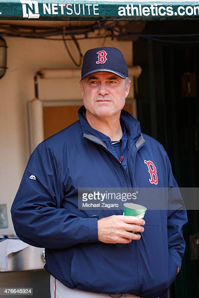 Manager John Farrell of the Boston Red Sox stands in the dugout prior to the game against the Oakland Athletics at Oco Coliseum on May 13 2015 in...