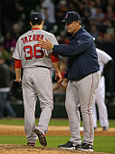 Manager John Farrell of the Boston Red Sox takes Junichi Tazawa out of the game in the 8th inning against the Chicago White Sox at US Cellular Field...