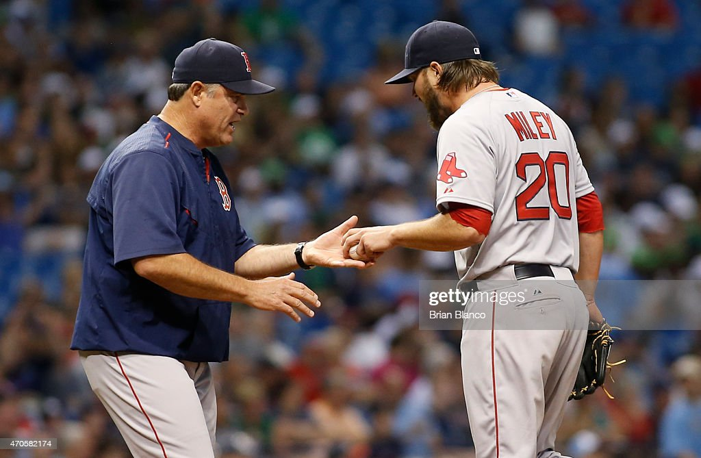 Manager John Farrell of the Boston Red Sox takes pitcher Wade Miley out of the game after Miley walked Evan Longoria of the Tampa Bay Rays to load...
