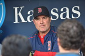 Manager John Farrell of the Boston Red Sox takes question in a media session in the dugout before the game against the Kansas City Royals at Kauffman...