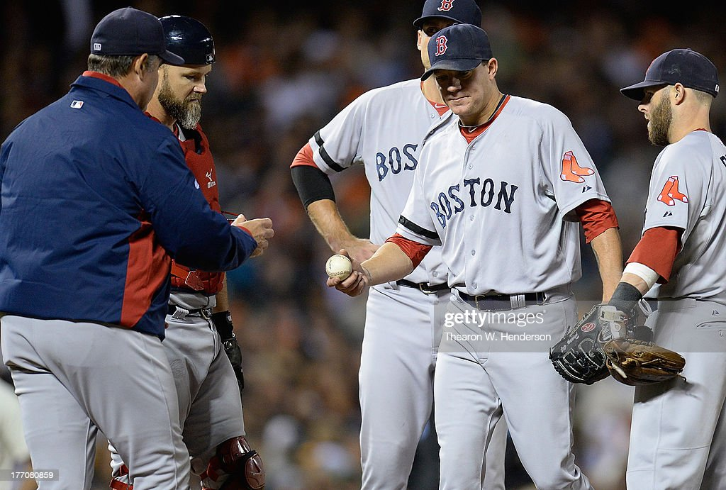 Manager John Farrell #53 of the Boston Red Sox takes the ball from pitcher <a gi-track='captionPersonalityLinkClicked' href=/galleries/search?phrase=Jake+Peavy&family=editorial&specificpeople=211320 ng-click='$event.stopPropagation()'>Jake Peavy</a> #44 taking him out of the game in the sixth inning against the San Francisco Giants at AT&T Park on August 20, 2013 in San Francisco, California.