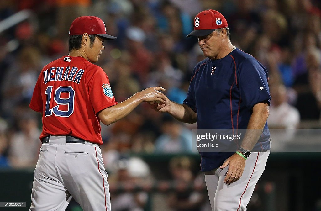 Manager John Farrell #53 of the Boston Red Sox takes the ball from pitcher Koji Uehara #19 in the fifth inning of the Spring Training Game against the Minnesota Twins on March 16, 2016 at CenturyLink Sports Complex and Hammond Stadium, Fort Myers, Florida.