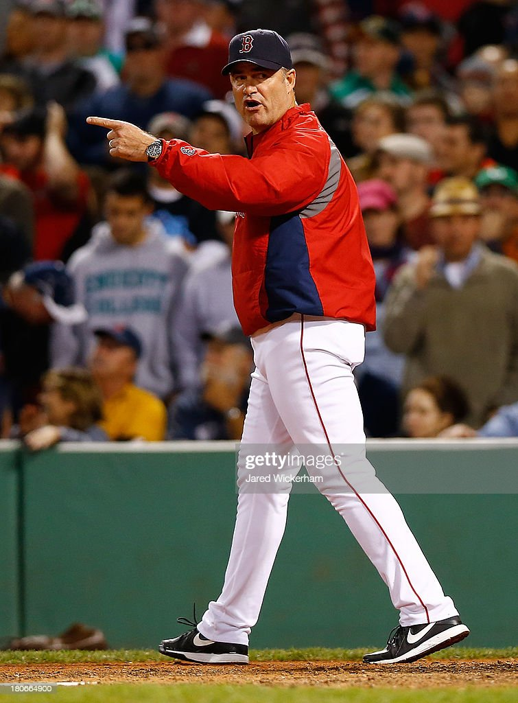 Manager John Farrell #53 of the Boston Red Sox talks to home plate umpire Ron Kulpa after throwing out Mike Napoli #12 of the Boston Red Sox in the 6th inning during the game on September 15, 2013 at Fenway Park in Boston, Massachusetts.