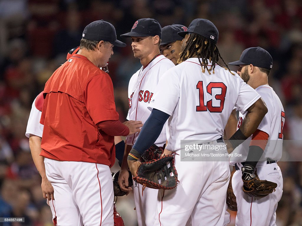 Manager John Farrell #53 of the Boston Red Sox talks to pitcher Clay Buchholz #11 after he allowed four earned runs against the Colorado Rockies in the fifth inning on May 26, 2016 at Fenway Park in Boston, Massachusetts.