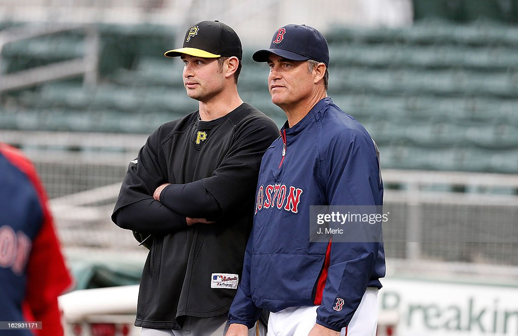 Manager John Farrell #53 of the Boston Red Sox talks with his son, infielder Jeremy Farrell #35 of the Pittsburgh Pirates during batting practice just before a Grapefruit League Spring Training Game at JetBlue Park on March 1, 2013 in Fort Myers, Florida.