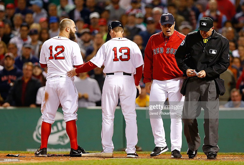 Manager John Farrell #53 of the Boston Red Sox talks with home plate umpire Ron Kulpa after throwing out Mike Napoli #12 of the Boston Red Sox in the 6th inning during the game on September 15, 2013 at Fenway Park in Boston, Massachusetts.