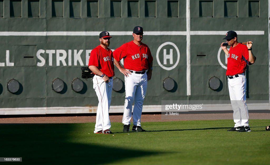 Manager John Farrell #53 (center) of the Boston Red Sox talks with Jonny Gomes #5 during batting practice just before the start of the Grapefruit League Spring Training Game against the Minnesota Twins at JetBlue Park on March 8, 2013 in Fort Myers, Florida.