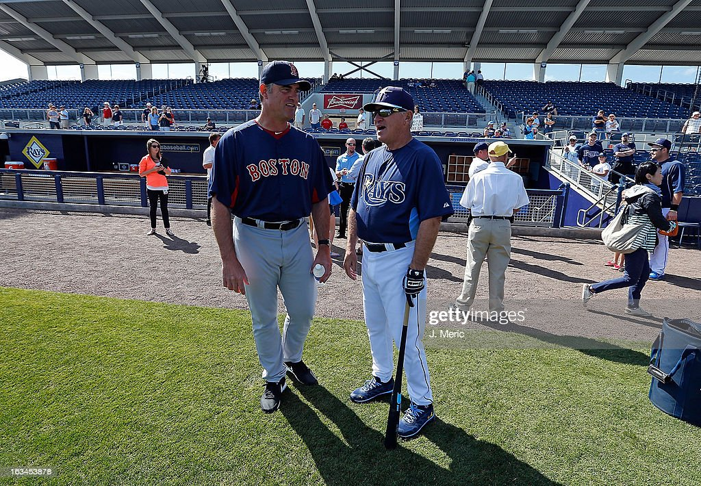 Manager John Farrell #53 (left) of the Boston Red Sox talks with manager Joe Maddon #70 of the Tampa Bay Rays just before a Grapefruit League Spring Training Game at the Charlotte Sports Complex on March 10, 2013 in Port Charlotte, Florida.