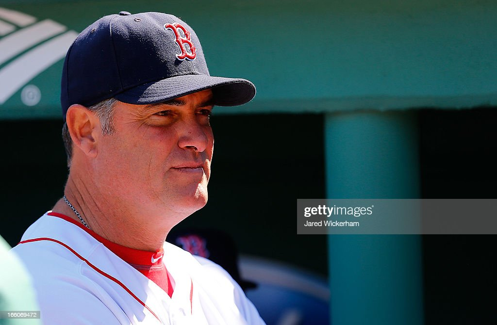 Manager John Farrell of the Boston Red Sox waits in the dugout during introductions prior to the Opening Day game against the Baltimore Orioles on April 8, 2013 at Fenway Park in Boston, Massachusetts.