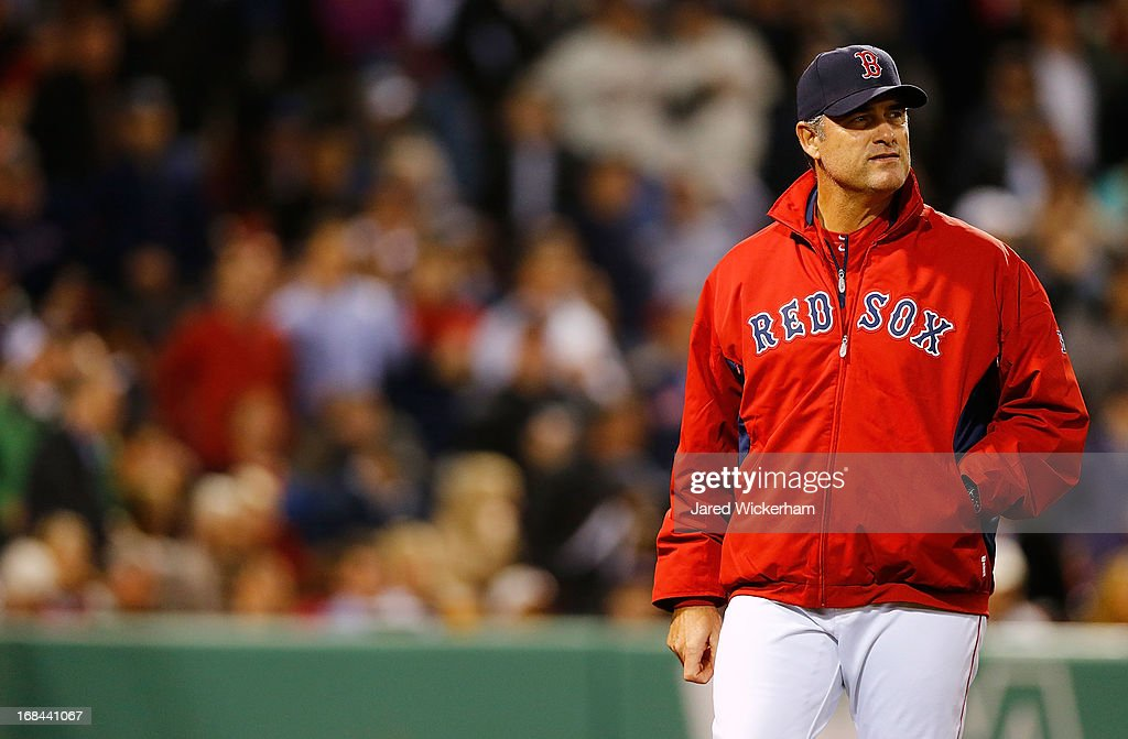 Manager John Farrell #53 of the Boston Red Sox walks back to the dugout after arguing a call at home plate against the Minnesota Twins during the game on May 9, 2013 at Fenway Park in Boston, Massachusetts.