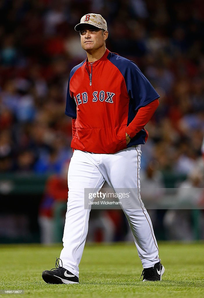 Manager John Farrell #53 of the Boston Red Sox walks back to the dugout during the interleague game against the Philadelphia Phillies on May 27, 2013 at Fenway Park in Boston, Massachusetts.