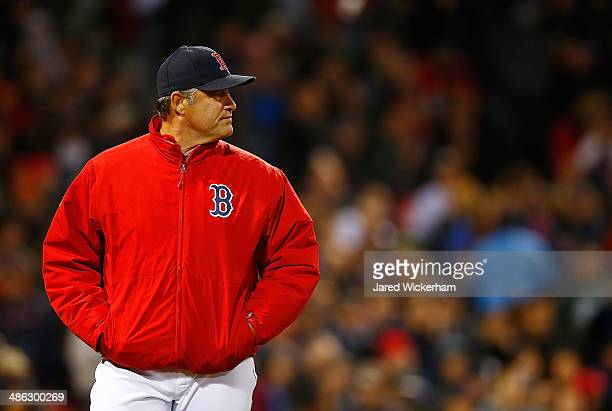 Manager John Farrell of the Boston Red Sox walks back to the dugout after talking with the umpires regarding a substance on pitcher Michael Pineda of...