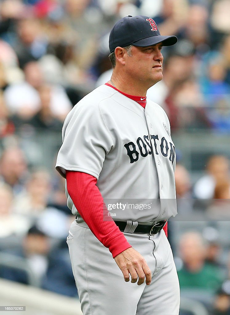 Manager John Farrell of the Boston Red Sox walks out on the field during Opening Day against the New York Yankees on April 1, 2013 at Yankee Stadium in the Bronx borough of New York City.