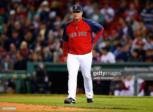 Manager John Farrell of the Boston Red Sox walks out to the mound for a pitching change in the 9th inning against the Detroit Tigers during the game...