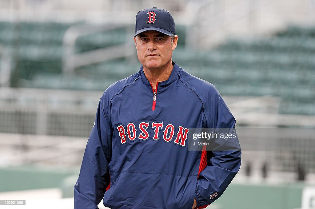 Manager John Farrell #53 of the Boston Red Sox watches his team take batting practice just before the Grapefruit League Spring Training Game against the Pittsburgh Pirates at JetBlue Park on March 1, 2013 in Fort Myers, Florida.