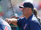 Manager John Farrell of the Boston Red Sox watches the team take batting practice prior to their spring training game against the St Louis Cardinals...