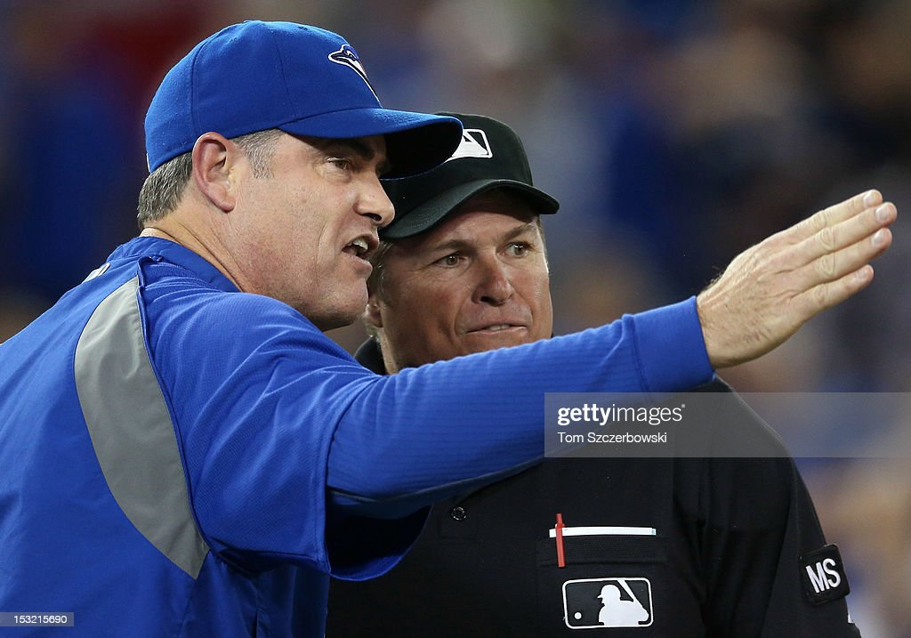 Manager John Farrell #52 of the Toronto Blue Jays argies a call in the tenth inning before being ejected by home plate umpire Marvin Hudson #51 during MLB game action against the Minnesota Twins on October 1, 2012 at Rogers Centre in Toronto, Ontario, Canada.