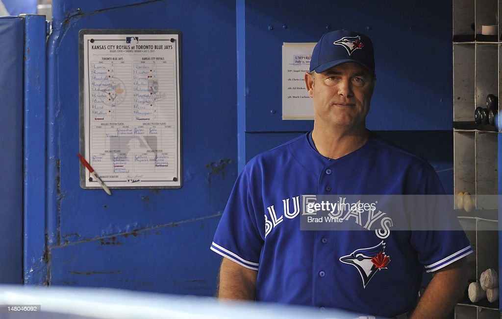 Manager John Farrell of the Toronto Blue Jays looks on rom the dugout during MLB game action against the Kansas City Royals July 3, 2012 at Rogers Centre in Toronto, Ontario, Canada.