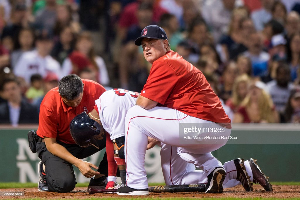 Manager John Farrell reacts as Eduardo Nunez #36 of the Boston Red Sox is injured during an at bat during the fourth inning of a game against the Toronto Blue Jays on September 25, 2017 at Fenway Park in Boston, Massachusetts.