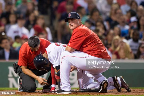 Manager John Farrell reacts as Eduardo Nunez of the Boston Red Sox is injured during an at bat during the fourth inning of a game against the Toronto...