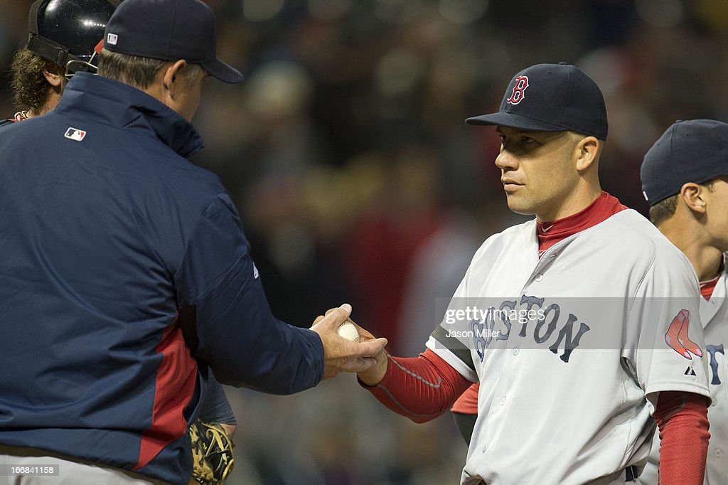 Manager John Farrell #53 removes starting pitcher <a gi-track='captionPersonalityLinkClicked' href=/galleries/search?phrase=Alfredo+Aceves&family=editorial&specificpeople=5514493 ng-click='$event.stopPropagation()'>Alfredo Aceves</a> #91 of the Boston Red Sox from the game after he gave up two home runs for three runs during the sixth inning against the Cleveland Indians at Progressive Field on April 17, 2013 in Cleveland, Ohio.