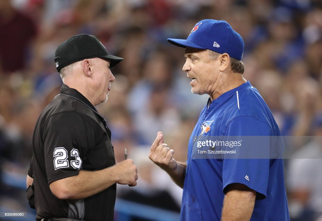 Manager John Gibbons #5 of the Toronto Blue Jays argues with home plate umpire Lance Barksdale #23 after he was ejected for arguing balls and strikes in the seventh inning during MLB game action against the Tampa Bay Rays at Rogers Centre on August 16, 2017 in Toronto, Canada.