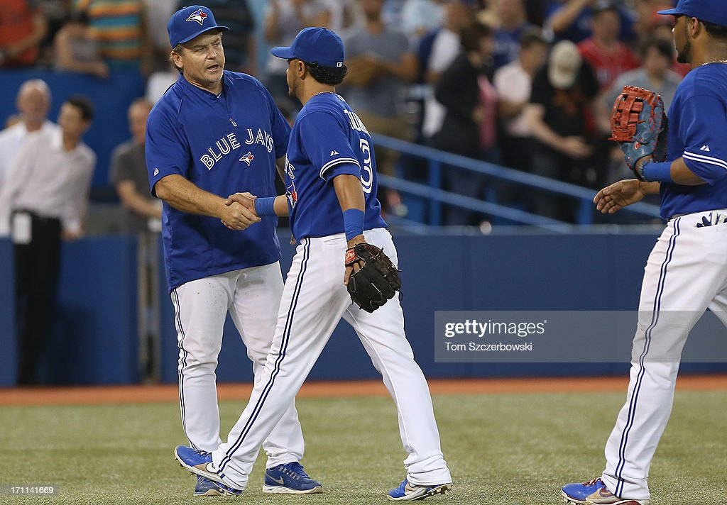 Manager <a gi-track='captionPersonalityLinkClicked' href=/galleries/search?phrase=John+Gibbons&family=editorial&specificpeople=218120 ng-click='$event.stopPropagation()'>John Gibbons</a> #5 of the Toronto Blue Jays congratulates <a gi-track='captionPersonalityLinkClicked' href=/galleries/search?phrase=Maicer+Izturis&family=editorial&specificpeople=239100 ng-click='$event.stopPropagation()'>Maicer Izturis</a> #3 after the team's tenth consecutive victory during MLB game action against the Baltimore Orioles on June 22, 2013 at Rogers Centre in Toronto, Ontario, Canada.