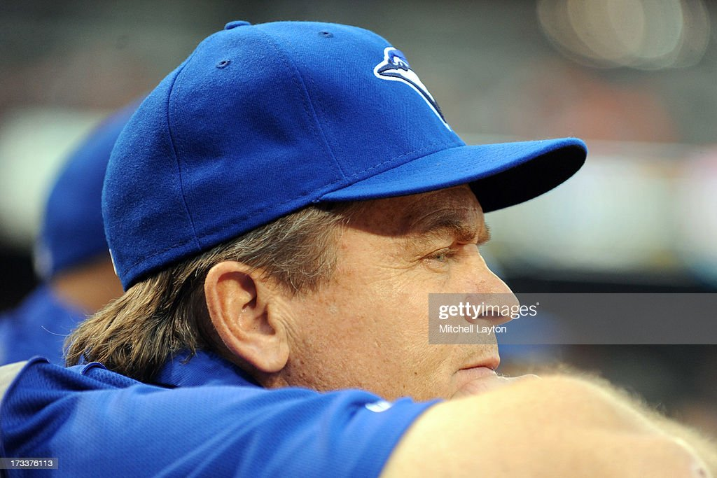 Manager <a gi-track='captionPersonalityLinkClicked' href=/galleries/search?phrase=John+Gibbons&family=editorial&specificpeople=218120 ng-click='$event.stopPropagation()'>John Gibbons</a> #5 of the Toronto Blue Jays looks on during a baseball game against the Baltimore Orioles on July 12, 2013 at Oriole Park at Camden Yards in Baltimore, Maryland.